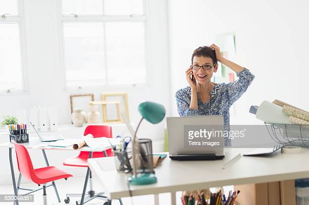 USA, New Jersey, Jersey City, Senior business woman using cell phone in office
