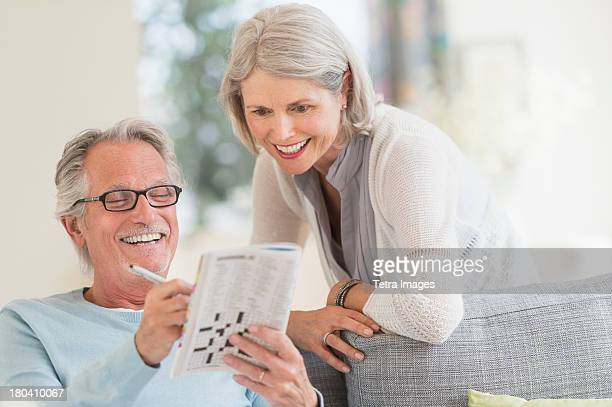 USA, New Jersey, Jersey City, Senior couple doing crossword
