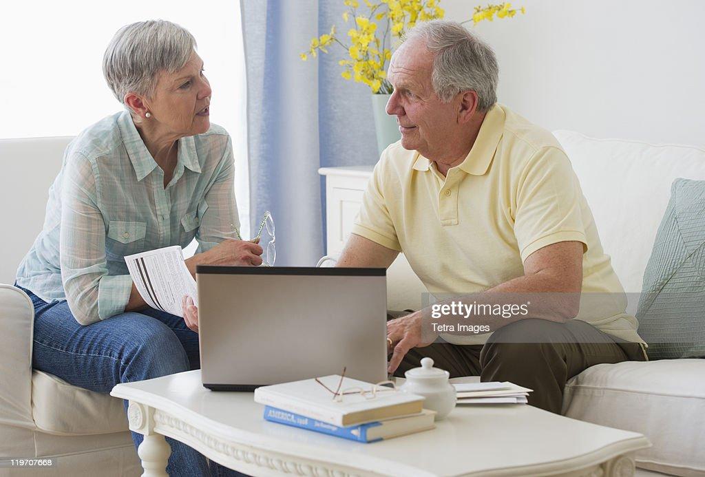 USA, New Jersey, Jersey City, Senior couple with laptop : Stock Photo