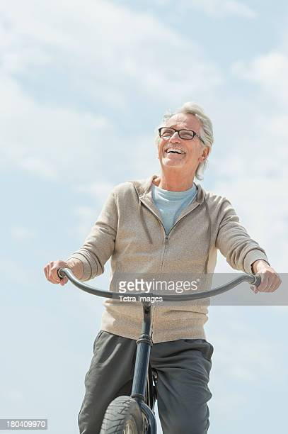 USA, New Jersey, Jersey City, Senior man riding bicycle