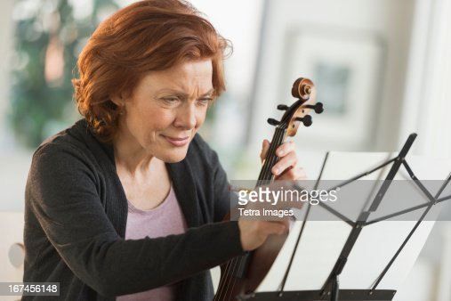 USA, New Jersey, Jersey City, Senior woman composing music : Stock Photo