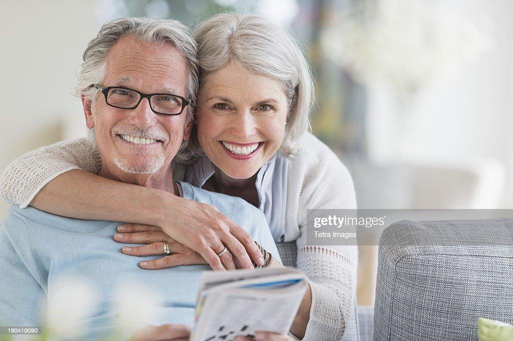 USA, New Jersey, Jersey City, Senior woman embracing senior man