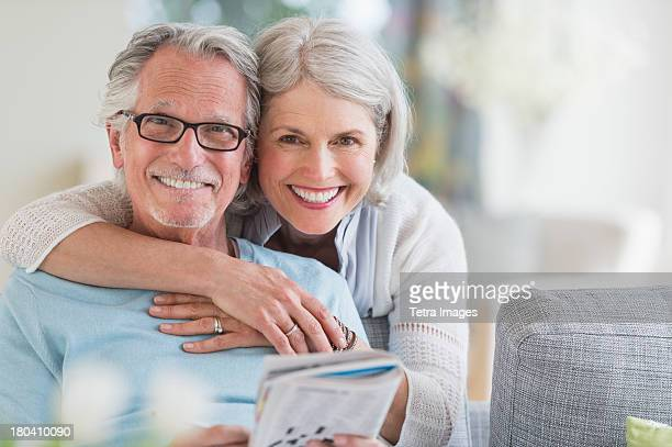 USA, New Jersey, Jersey City, Senior woman embracing senior man