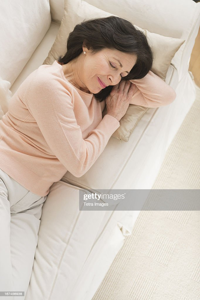 USA, New Jersey, Jersey City, Senior woman napping on sofa : Stock Photo