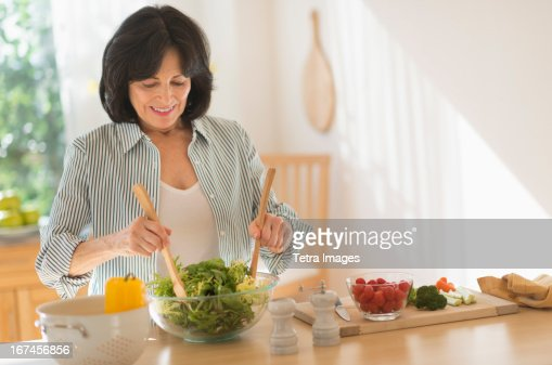 USA, New Jersey, Jersey City, Senior woman preparing salad : Stock Photo