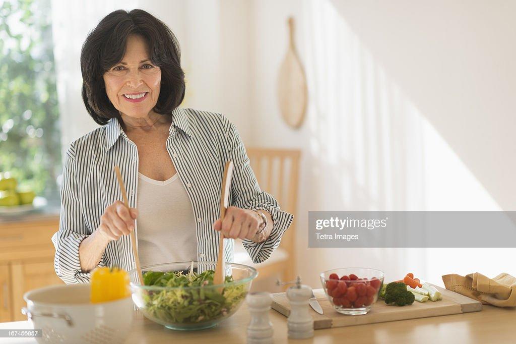 USA, New Jersey, Jersey City, Senior woman preparing salad : Stock Photo