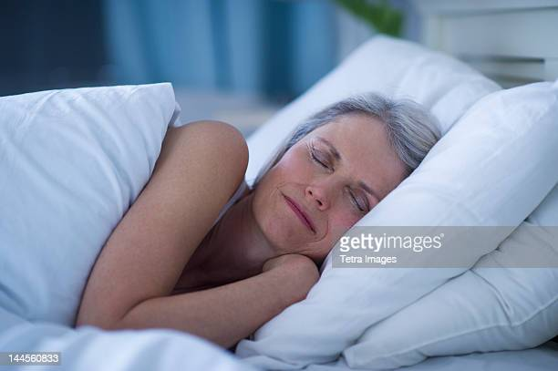 USA, New Jersey, Jersey City, Senior woman sleeping in bed