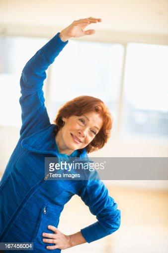 USA, New Jersey, Jersey City, Senior woman stretching : Stock Photo