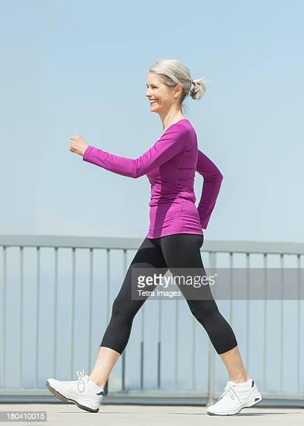 USA, New Jersey, Jersey City, Senior woman walking