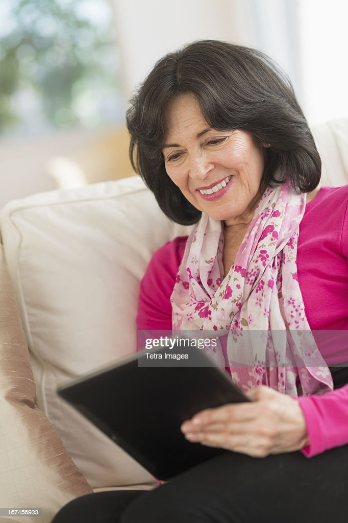 USA, New Jersey, Jersey City, Senior woman with digital tablet : Stock Photo