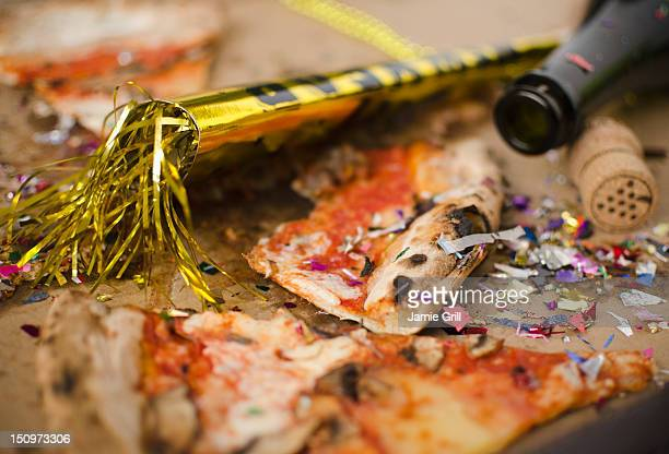 USA, New Jersey, Jersey City, Slices of pizza and confetti in in box