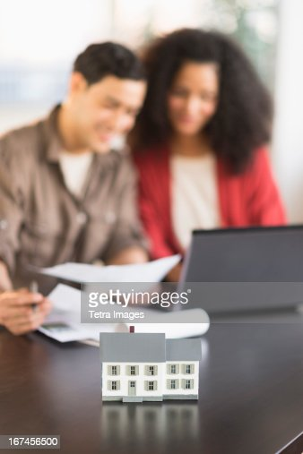 USA, New Jersey, Jersey City, Smiling couple planning home ownership with model home : Stock Photo
