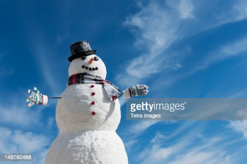 USA, New Jersey, Jersey City, Snowman under blue sky