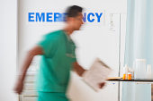 USA, New Jersey, Jersey City, Surgeon entering emergency room
