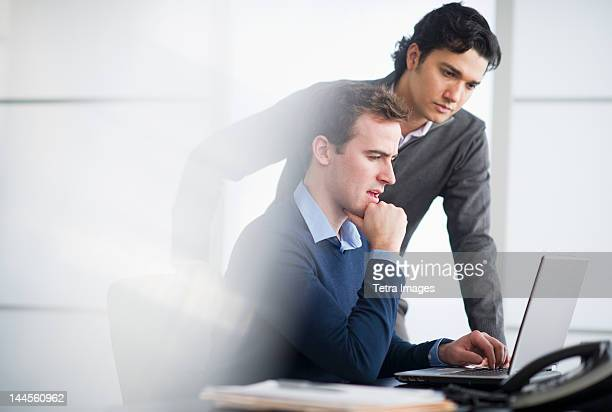 USA, New Jersey, Jersey City, Two businessmen working with laptop