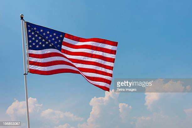 USA, New Jersey, Jersey City, US flag against blue sky