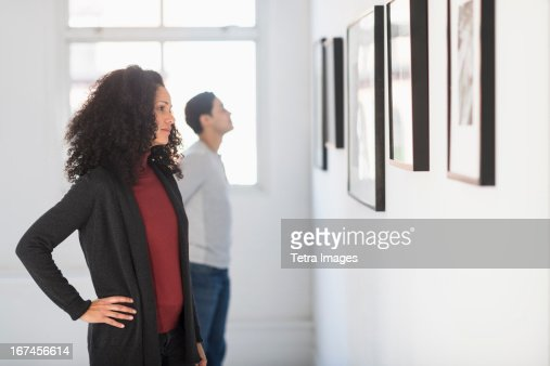 USA, New Jersey, Jersey City, Visitors looking at artworks in gallery : Stock Photo