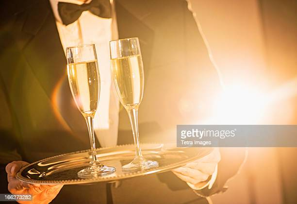 USA, New Jersey, Jersey City, Waiter holding tray with champagne