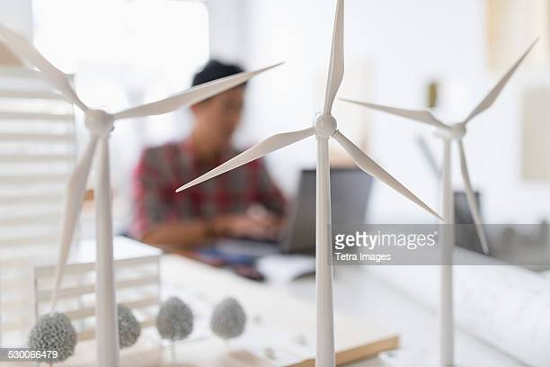 USA, New Jersey, Jersey City, Wind turbine models on desk, architect in background