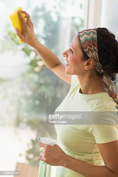 USA, New Jersey, Jersey City, Woman cleaning window