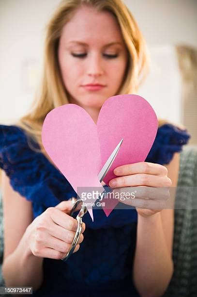 USA, New Jersey, Jersey City, Woman cutting paper heart
