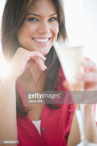 USA, New Jersey, Jersey City, Woman drinking champagne