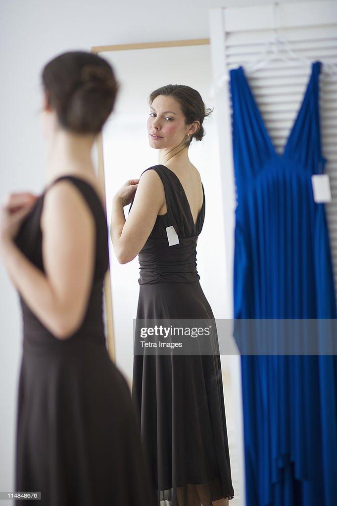 USA, New Jersey, Jersey City, Woman fitting new dress