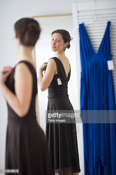 USA, New Jersey, Jersey City, Woman fitting new dress