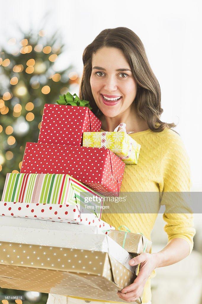 USA, New Jersey, Jersey City, Woman holding christmas gifts : Stock Photo