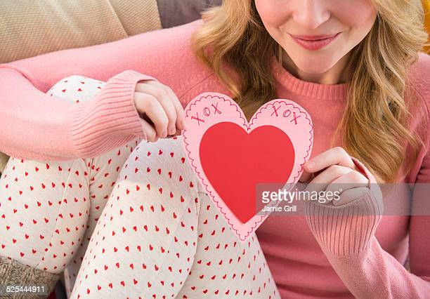 USA, New Jersey, Jersey City, Woman holding heart shape valentine's card