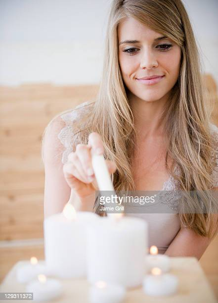 USA, New Jersey, Jersey City, Woman igniting candles in spa