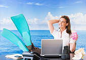 USA, New Jersey, Jersey City, Woman in flippers daydreaming at desk