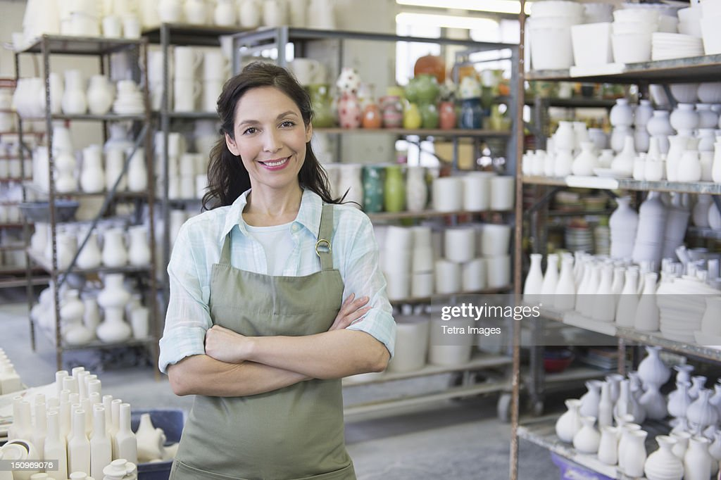 USA, New Jersey, Jersey City, Woman in pottery warehouse