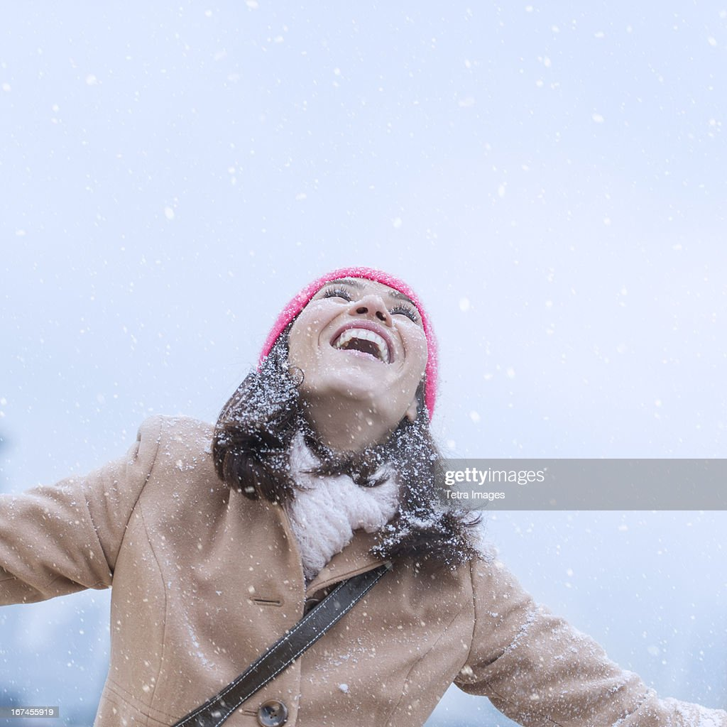 USA, New Jersey, Jersey City, Woman in snowfall : Stock Photo