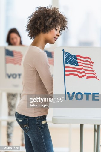 USA, New Jersey, Jersey City, Woman in voting booth