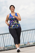 USA, New Jersey, Jersey City, Woman jogging on bridge