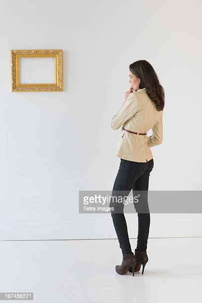 USA, New Jersey, Jersey City, Woman looking at picture in art gallery