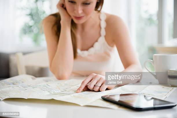 USA, New Jersey, Jersey City, Woman making travel plans