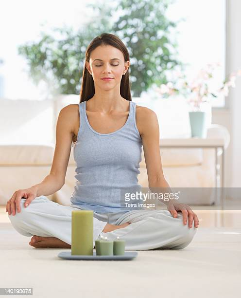 USA, New Jersey, Jersey City, Woman meditating at home