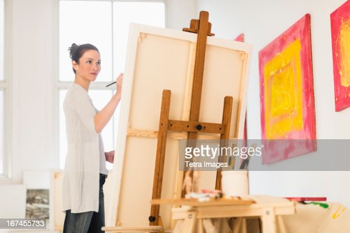 USA, New Jersey, Jersey City, Woman painting at easel