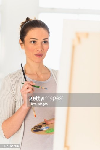 USA, New Jersey, Jersey City, Woman painting at easel : Stock Photo