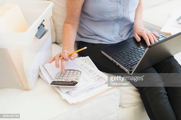 USA, New Jersey, Jersey City, Woman paying bills via internet
