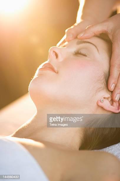 USA, New Jersey, Jersey City, Woman receiving face massage