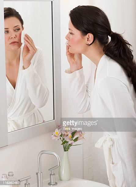 USA, New Jersey, Jersey City, woman removing make-up in bathroom