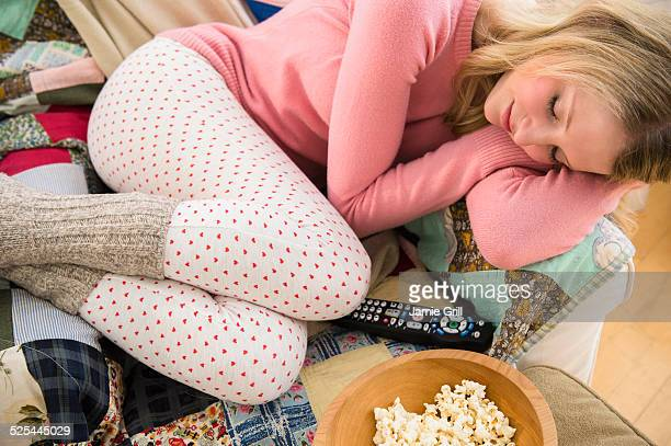 USA, New Jersey, Jersey City, Woman sleeping on sofa