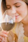 USA, New Jersey, Jersey City, Woman smelling wine