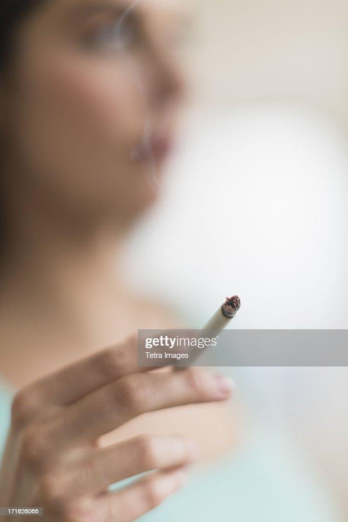 USA, New Jersey, Jersey City, Woman smoking cigarette