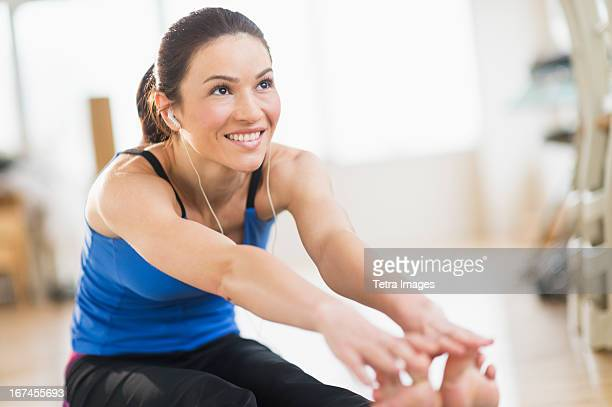 USA, New Jersey, Jersey City, Woman stretching