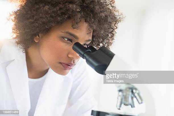 USA, New Jersey, Jersey City, Woman using microscope in laboratory