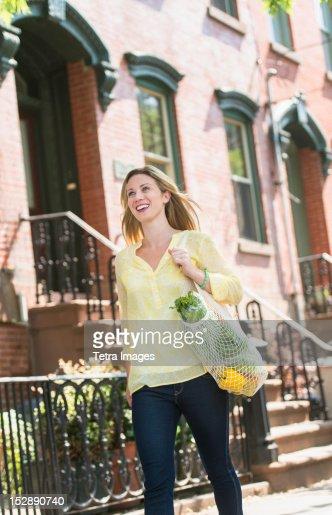 USA, New Jersey, Jersey City, Woman walking in street